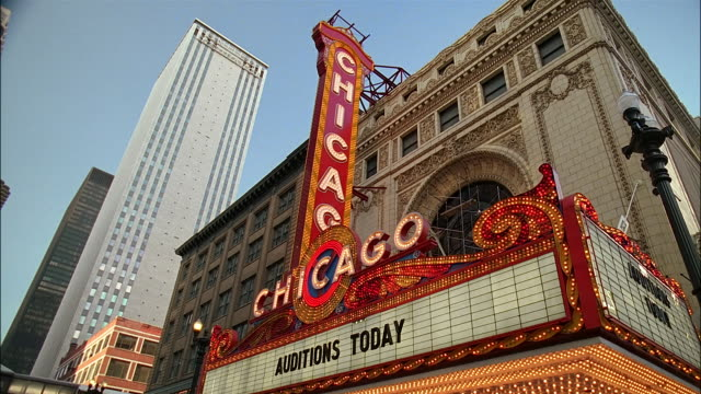 low angle medium shot illuminated chicago theatre marquee / auditions today / chicago, illinois - theatre banner commercial sign stock videos & royalty-free footage