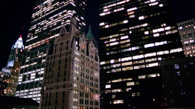 Low angle medium shot Liberty Tower, AIG Building, Chase Manhattan Bank Tower and HSBC Bank Building at night / NYC