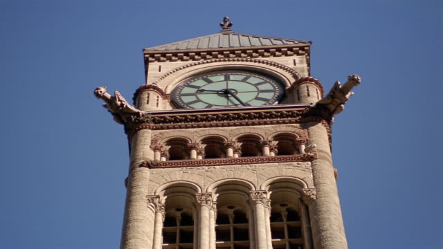 low angle medium shot looking up at clock and gargoyles on tower of old city hall at 9:25 a.m. / toronto - kelly mason videos stock videos & royalty-free footage