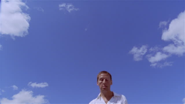 vídeos de stock e filmes b-roll de low angle medium shot man jumping on trampoline/ saint-ferme, france - trampolim equipamento desportivo