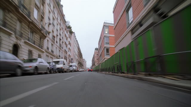 low angle medium shot motorcycle point of view traveling along narrow city street / paris - boundary stock videos & royalty-free footage