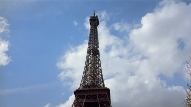 low angle medium shot pan from feet to summit of eiffel tower / paris - 1990 stock videos & royalty-free footage