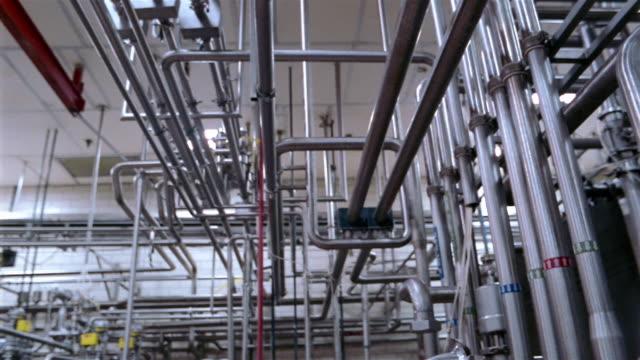 Low angle medium shot pan network of pipes at a water purification plant / San Antonio, Texas
