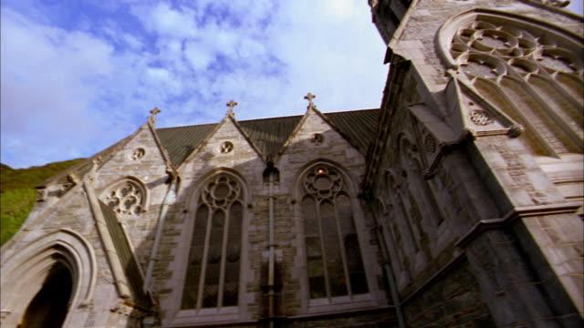 low angle medium shot pan stone church exterior / ireland - 2002 stock videos & royalty-free footage