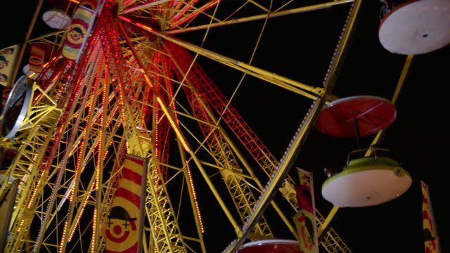 low angle medium shot people riding giant wheel at canadian national exhibition at night / toronto - kelly mason videos stock-videos und b-roll-filmmaterial