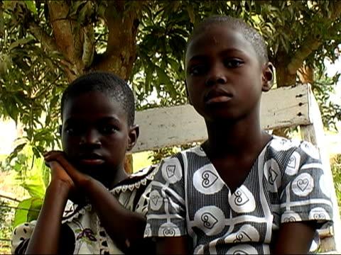 Low angle medium shot portrait two boys/ Ghana