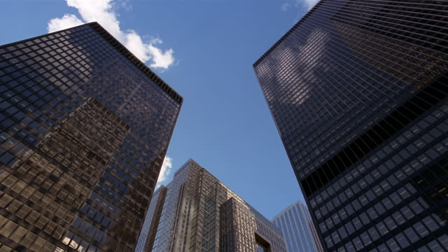 low angle medium shot royal bank plaza and passing clouds reflected on glass of toronto-dominion centre tower/ toronto - kelly mason videos stock videos & royalty-free footage