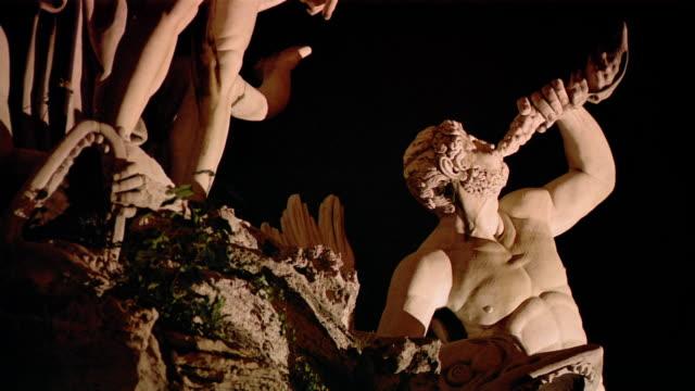 low angle medium shot statue of triton in fountain in piazza del popolo / rome, italy - mythologie stock-videos und b-roll-filmmaterial
