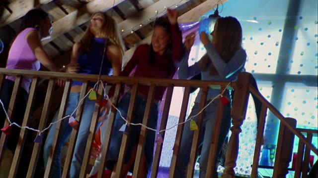 low angle medium shot teen girls dancing on balcony during house party - early rock & roll stock videos & royalty-free footage