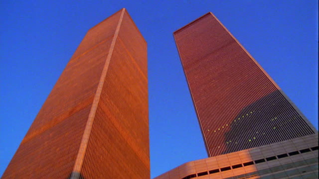 low angle medium shot tilt down tilt up twin towers of world trade center / new york city - world trade center manhattan stock videos & royalty-free footage