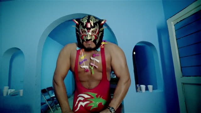 "low angle medium shot tilt up luchador ""black tiger"" posing in doorway/ monterrey, mexico - messico video stock e b–roll"