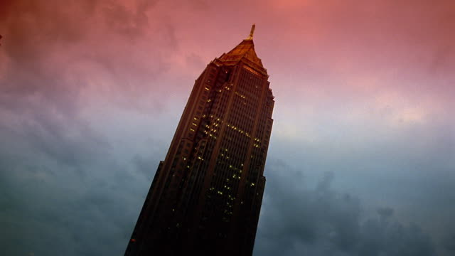 Low angle medium shot time lapse clouds rolling over Bank of America Plaza / Atlanta, Georgia