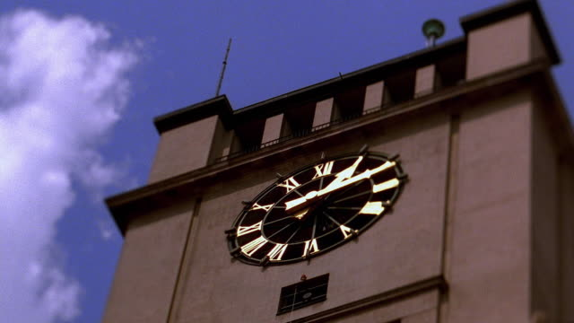 Low angle medium shot time lapse clouds rolling over Schoneberg Rathaus clocktower / Berlin, Germany
