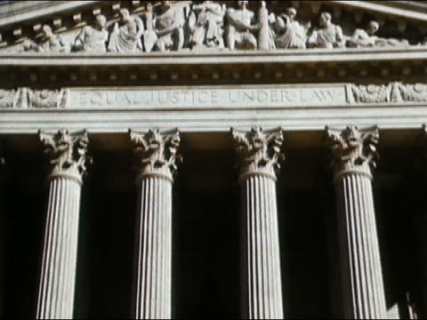 1964 low angle medium shot us supreme court building / zoom in equal justice under law inscription / washington dc - law stock videos and b-roll footage