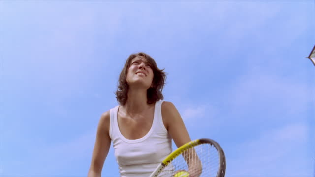 low angle medium shot woman serving in tennis/ saint-ferme, france - serving sport stock videos and b-roll footage