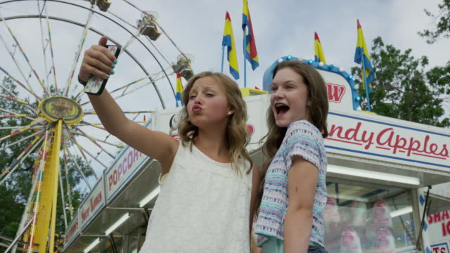 low angle medium slow motion shot of girls taking self-portrait with cell phone / pleasant grove, utah, united states - only girls stock videos and b-roll footage
