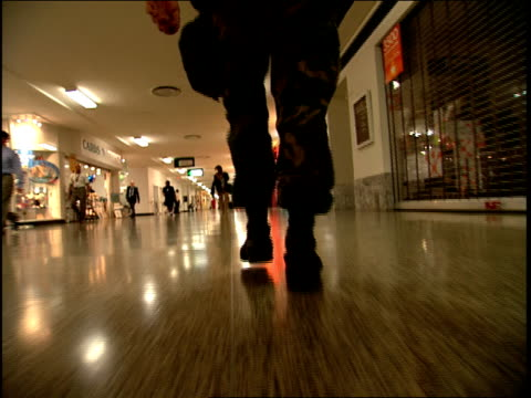 low angle medium tracking shot soldier walking through mall in pentagon/ arlington, virginia - the pentagon stock videos & royalty-free footage