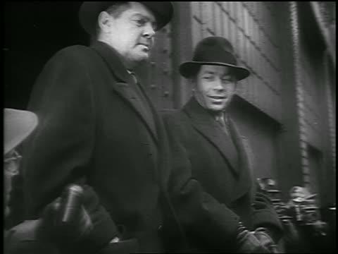 b/w 1950 low angle pan men boarding ship / deportation of soviet spy valentin gubachev / newsreel - communism stock videos & royalty-free footage