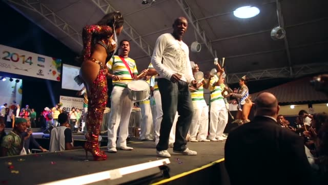 low angle mid shot, contestants for queen perform at the ceremony deciding rio's 2014 carnival queen and king in the port district on november 8,... - spielkandidat stock-videos und b-roll-filmmaterial