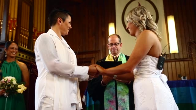 low angle mid shot, natasha vitali and melissa ray are married by marriage celebrant rev matt tittle at the auckland unitary church on august 19,... - oceania stock videos & royalty-free footage