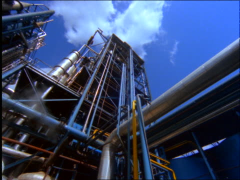 low angle PAN of network of pipes at oil refinery / Brazil