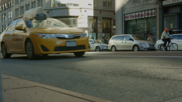 low angle new york city traffic with sun spot - yellow taxi stock videos and b-roll footage