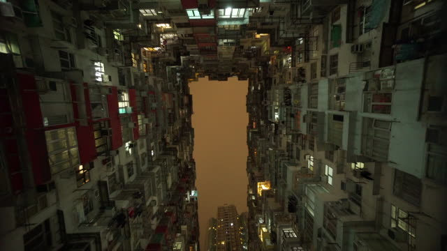 low angle, night sky in hong kong apartments - inquadratura estrema dal basso video stock e b–roll