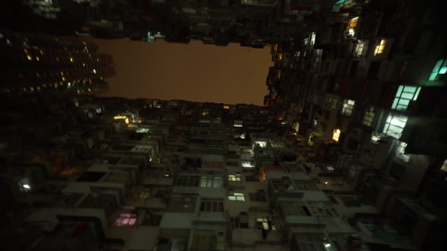 low angle, night sky over apartment complex in hong kong - spinning point of view stock videos & royalty-free footage