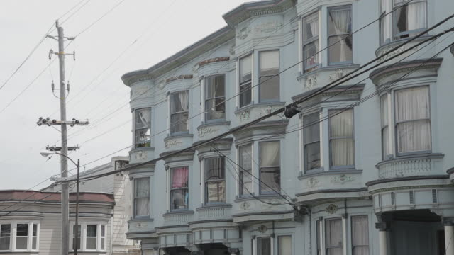 low angle of a rowhouse in san francisco - victorian stock videos & royalty-free footage