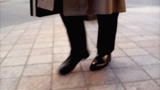 Low angle of businessperson's feet walking brisky