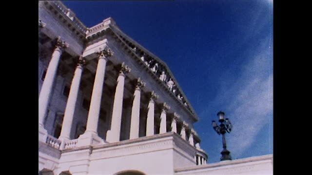 low angle of capitol building against blue sky; 1972 - washington dc stock videos & royalty-free footage