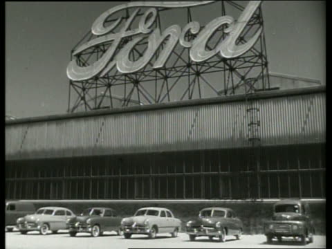 B/W low angle of Ford car factory with sign / SOUND