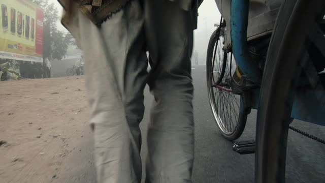 ms low angle of man pulling rickshaw on road / rishikesh, uttarakhand, india - rickshaw stock videos and b-roll footage