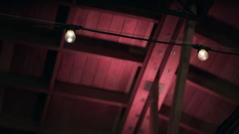 low angle of market lights inside barn - barn stock videos & royalty-free footage