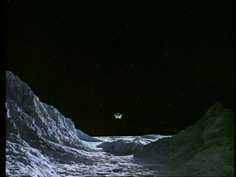 low angle of moon bus flying over rocky moon or planet surface - 撮影現場点の映像素材/bロール