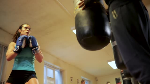 low angle of punching bag - kickboxing stock videos and b-roll footage