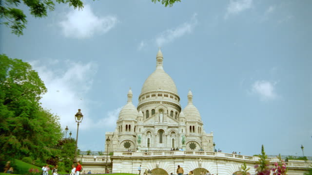 low angle of sacre coeur with blue sky in background / paris - basilique du sacre coeur montmartre stock videos & royalty-free footage