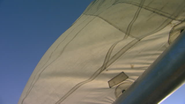 low angle of sail in wind, handheld - sail stock videos and b-roll footage