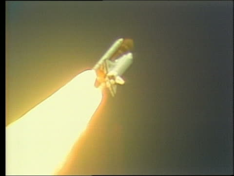 low angle of space shuttle discovery ascending in sky - 1988 stock videos & royalty-free footage