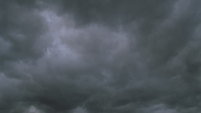 low angle of thick grey time lapse storm clouds - storm cloud stock videos & royalty-free footage