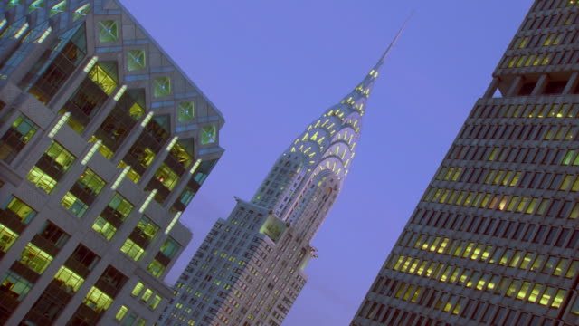 stockvideo's en b-roll-footage met canted low angle of time lapse chrysler building day to night / nyc - chrysler
