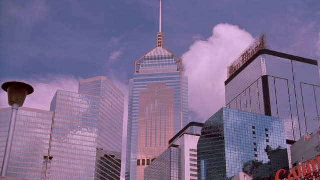 low angle of time lapse clouds over central plaza bldg and others / wanchai district, hong kong - central plaza hong kong stock videos & royalty-free footage