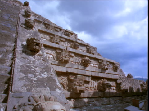 low angle of time lapse clouds over mayan ruins / mexico - latin american civilizations stock videos and b-roll footage