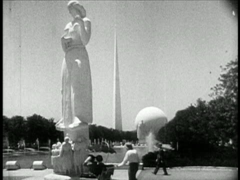 b/w 1940 low angle one of the statues of the four freedoms at new york world's fair / travelogue - flushing meadows corona park stock videos and b-roll footage