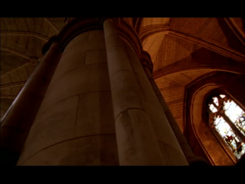 MCU Low angle, Pan right across pillar and vaulted ceiling of church, Guildhall, London, England
