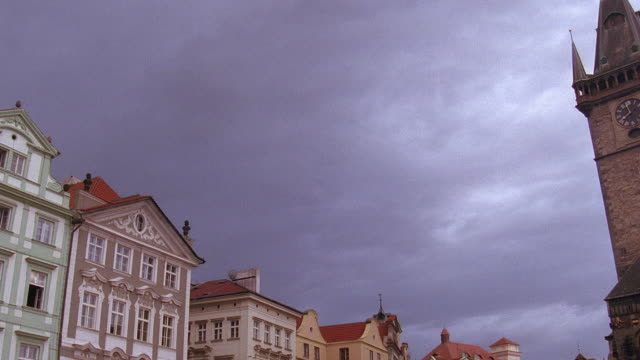 low angle pan time lapse clouds rolling over buildings and old town tower clock tower / prague, czech republic - stare mesto stock videos & royalty-free footage