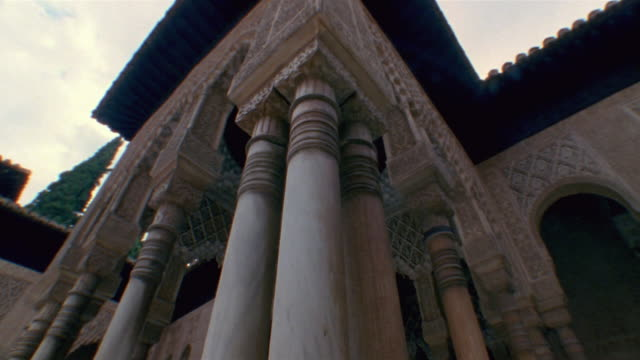 low angle pan up marble column on pavilion at court of lions/ alhambra, spain - pavilion stock videos & royalty-free footage