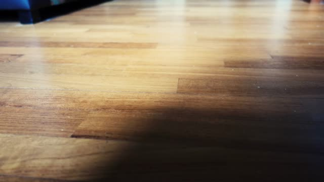 low angle panning across hardwood floor of a room - wooden floor stock videos & royalty-free footage