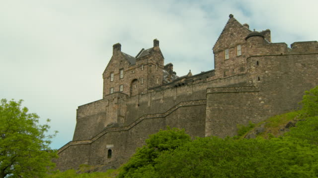 low angle panning shot of historic castle in city against sky - edinburgh, scotland - fortress stock videos & royalty-free footage