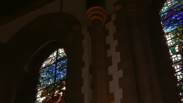 low angle panning shot of stained glass windows inside famous public university - glasgow, scotland - female likeness stock videos & royalty-free footage
